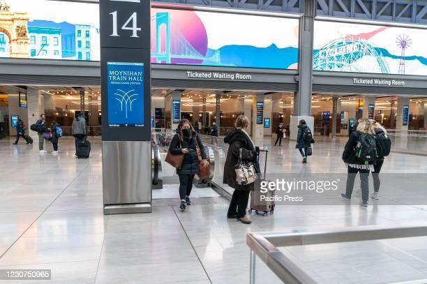 Travelers seen on Moynihan Train Hall arriving on Amtrak train from Boston on Penn Station. On January 21, 2021 President Joe Biden signed executive...