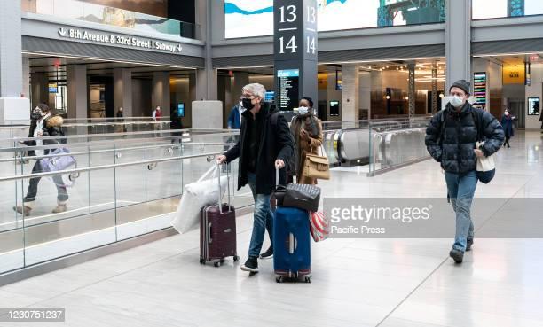Travelers seen on Moynihan Train Hall going to board on Amtrak train going along the East Coast from Penn Station. On January 21, 2021 President Joe...