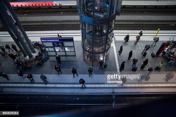 Travelers stand on a railway platform as a train arrives at Berlin Central Station in Berlin Germany on Friday Dec 8 2017 Germany's Chancellor Angela...