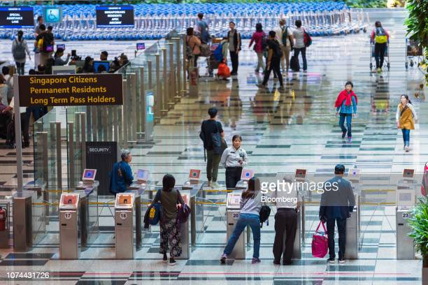 Travelers use automated immigration clearance machines at Terminal 1 of Changi Airport in Singapore on Thursday Dec 13 2018...