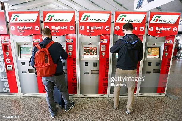 Travelers use Trenitalia SpA selfservice tickets machines at Termini train station in Rome Italy on Tuesday Feb 9 2016 The Poste Italiane IPO which...