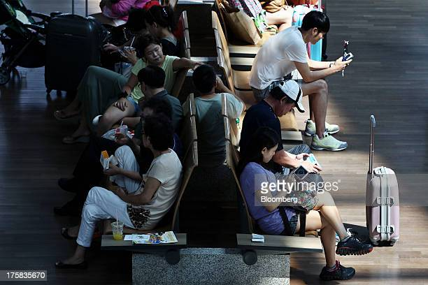 Travelers wait at Incheon International Airport in Incheon South Korea on Thursday Aug 8 2013 South Korea plans to tighten aviation rules and could...