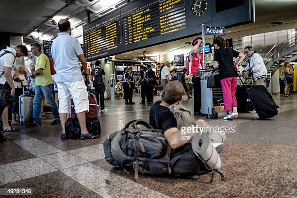 Travelers wait at the PartDieu railway station on July 26 2012 after TGV train services were severely disrupted between Paris and southeastern France...