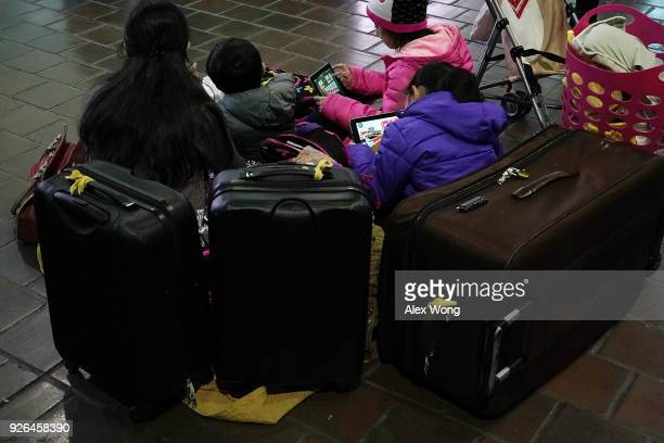 Travelers wait for Amtrak to resume its service March 2 2018 at Union Station in Washington DC Amtrak has cancelled all service on its Northeast...