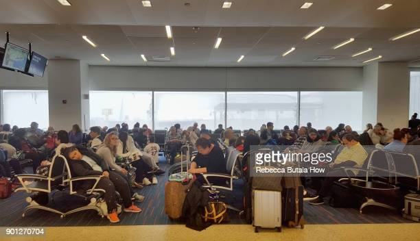 Travelers wait for delayed flights in terminal five at John F Kennedy International Airport on January 4 2018 in the Queens borough of New York City...