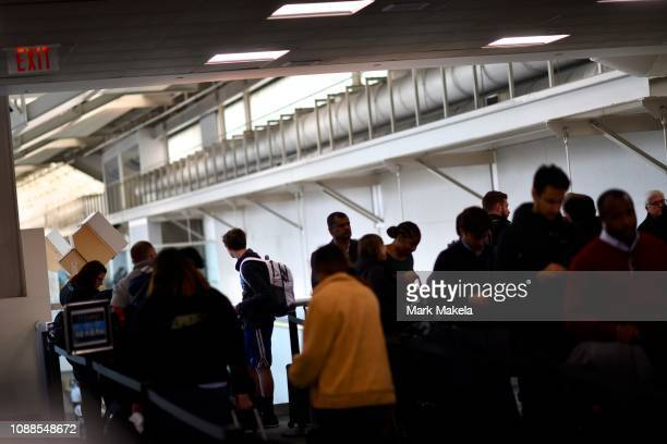 Travelers wait in a long security line after Philadelphia Airport TSA and airport workers held a protest rally outside the Philadelphia International...