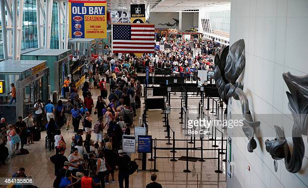 Travelers wait in line at the Southwest ticket check in at Baltimore/Washington International Thurgood Marshall Airport as flights are delayed due to...