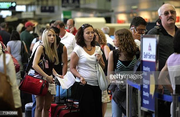 Travelers wait in line in Terminal 3 June 30, 2006 at O'Hare International Airport in Chicago, Illinois. Heavy holiday travel is expected as the U.S....