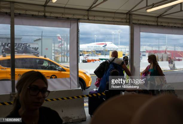 Travelers wait in line to catch a taxi at the John F. Kennedy International Airport in New York City, New York.
