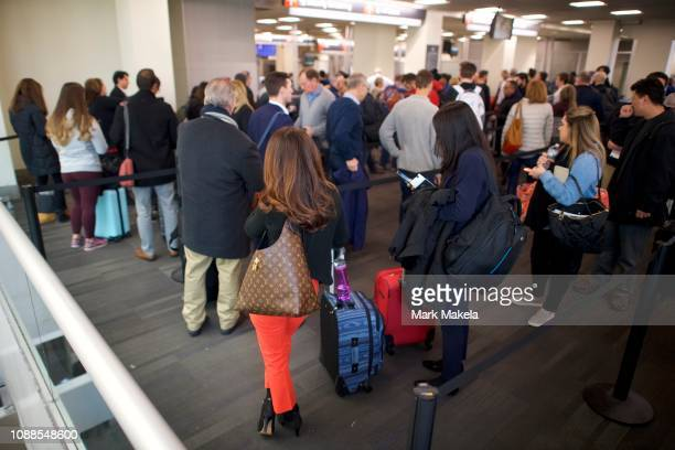 Travelers wait in long lines after Philadelphia Airport TSA and airport workers held a protest rally outside the Philadelphia International Airport...