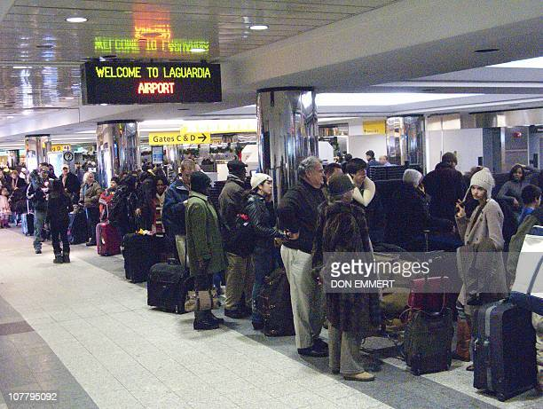 Travelers wait in ticketing lines at LaGuardia airport trying to get a flight out December 28 2010 New York The blizzard that made its way up the...