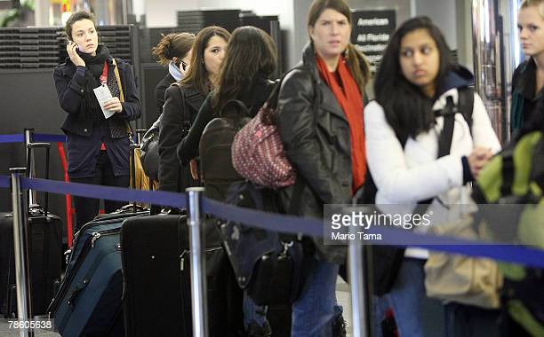 Travelers wait on line in the terminal to fly at LaGuardia Airport December 21, 2007 in the Queens borough of New York City. Travelers nationwide are...