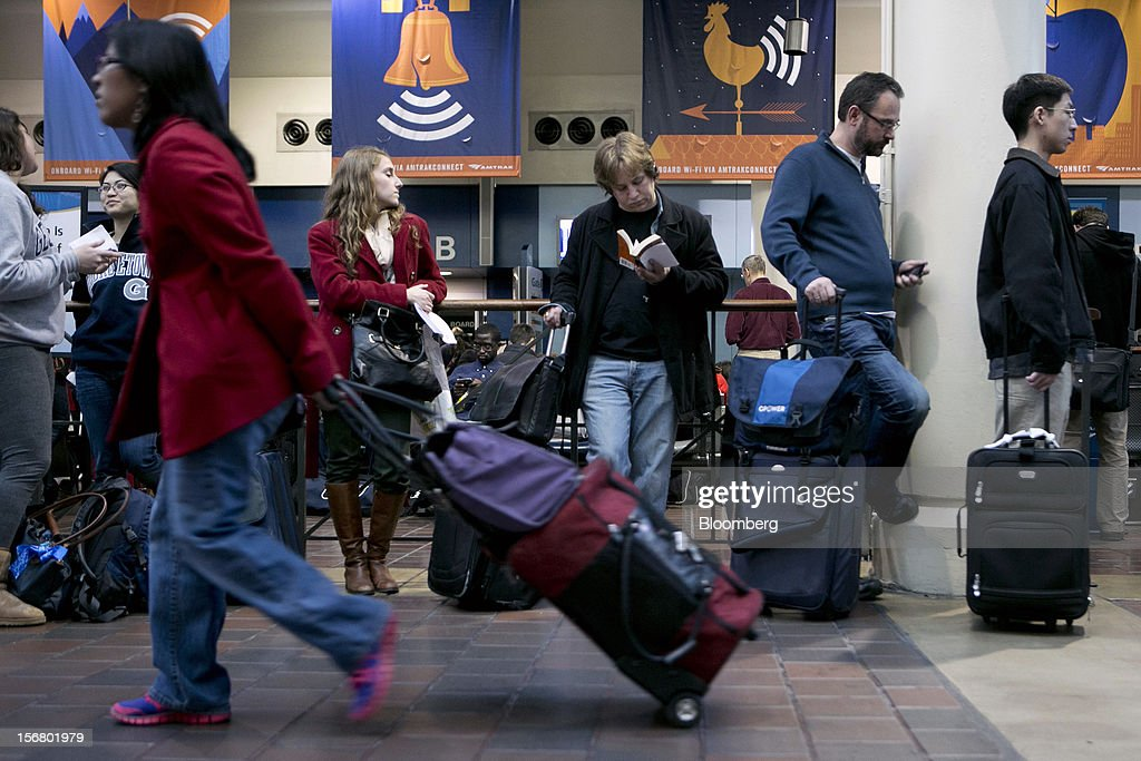Travelers wait to board an Amtrak train at Union Station in Washington, D.C., U.S., on Wednesday, Nov. 21, 2012. U.S. travel during the Thanksgiving holiday weekend will rise a fourth straight year, gaining 0.7 percent from 2011, as trips by automobile rise even as airplane trips decline, AAA said last week. Photographer: Andrew Harrer/Bloomberg