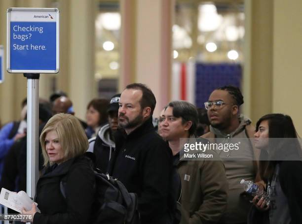 Travelers wait to check in at Reagan National Airport on November 21 2017 in Arlington Virginia Heavy air travel is expected for this Thanksgiving...