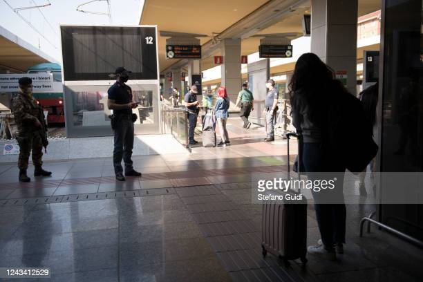 Travelers wait with their luggage at the Porta Nuova railway station on June 03 2020 in Turin Italy Today 3 June the Italian government has reopened...