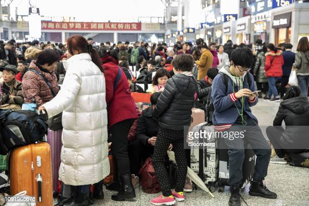 Travelers wait with their luggage in the main hall of the Shanghai Hongqiao Railway Station in Shanghai China on Wednesday Jan 30 2019 Chinese New...