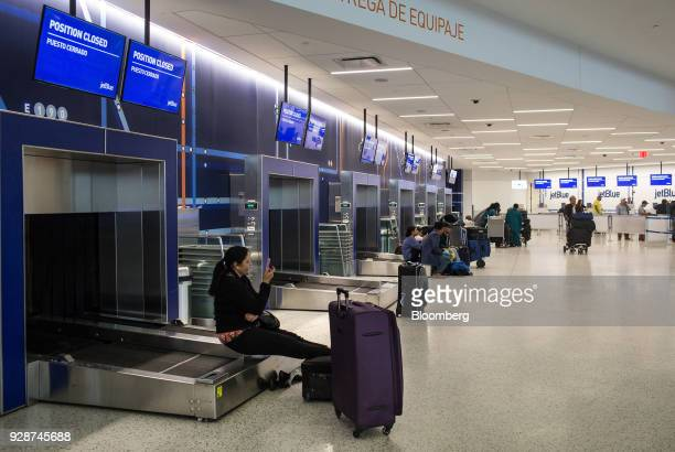 Travelers waited for information about cancelled and delayed flights at John F Kennedy International Airport during Winter Storm Quinn in New York US...