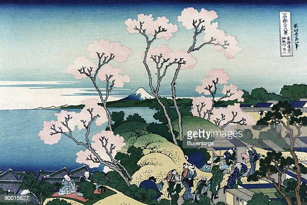 Travelers walk along the Tokaido road and some stop and rest on a blanket Cherry blossoms in bloom