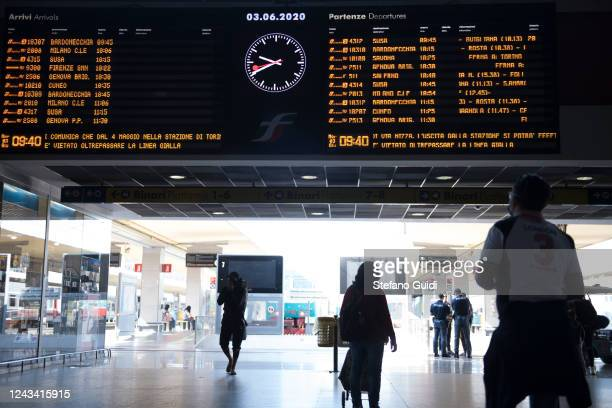 Travelers walk by at the Porta Nuova railway station on June 03 2020 in Turin Italy Today 3 June the Italian government has reopened the regional...