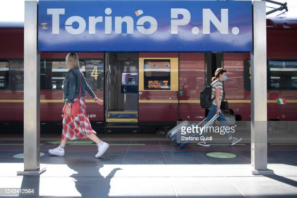 Travelers walk by the platform at the Porta Nuova railway station on June 03 2020 in Turin Italy Today 3 June the Italian government has reopened the...