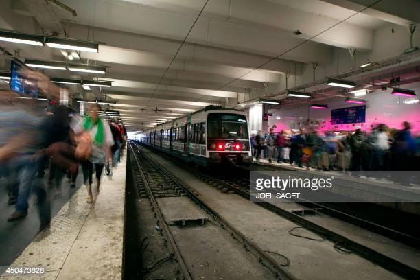 Travelers walk on the platforms of the Gare du Nord railway station on June 12 2014 in Paris on the second day of a national strike by French SNCF...
