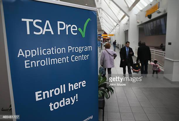 Travelers walk past a newlyopened TSA Precheck application center at Terminal C of the LaGuardia Airport on January 27 2014 in New York City Once...
