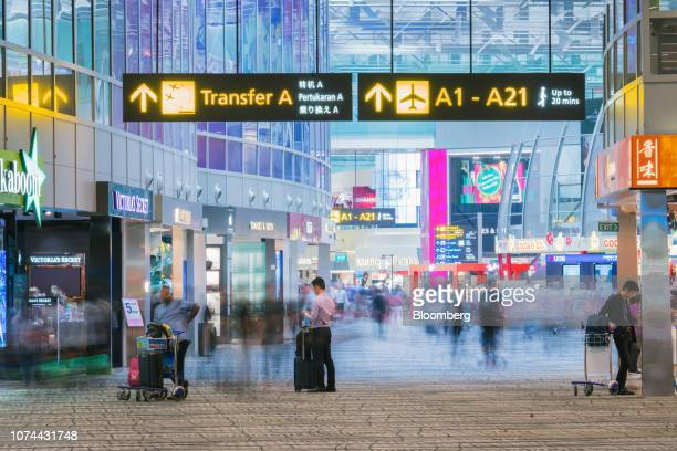 Travelers walk past stores at Terminal 3 of Changi Airport in Singapore on Thursday Dec 13 2018 Singapore'sChangiAirport votedtheworld's bestfor...