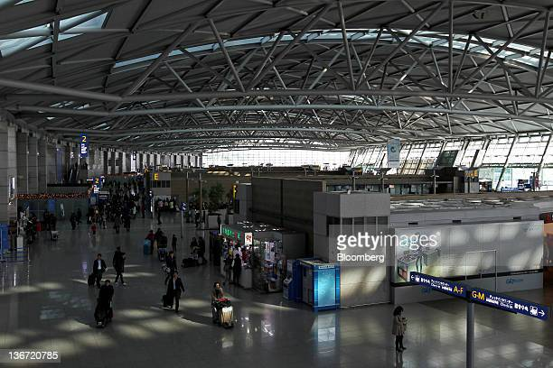 Travelers walk through Incheon International Airport in Incheon South Korea on Tuesday Jan 10 2012 Incheon International Airport Corp operator of...
