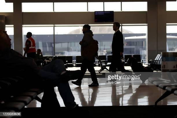Travelers walk through terminal A at HartsfieldJackson Atlanta International Airport on April 20 2020 in Atlanta Georgia The airline industry has...