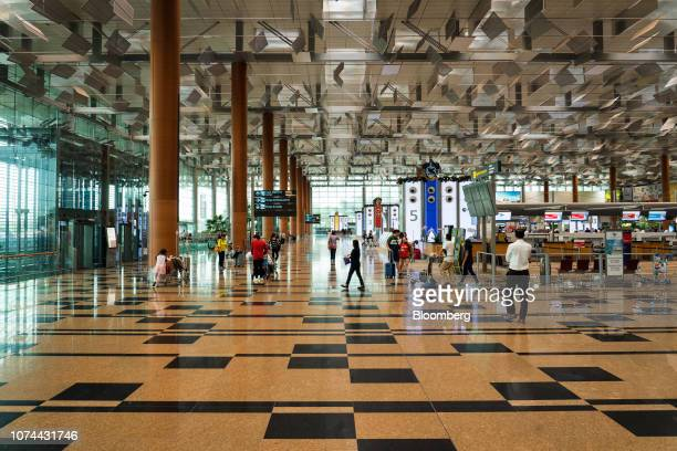 Travelers walk through the departure hall at Terminal 3 of Changi Airport in Singapore on Thursday Dec 13 2018 Singapore'sChangiAirport...