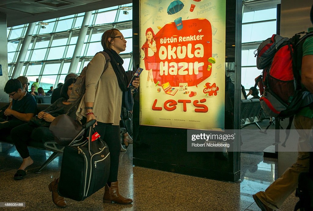 Travelers walk to their departure gate September 5, 2015 at the Istanbul Ataturk Airport in Istanbul, Turkey.