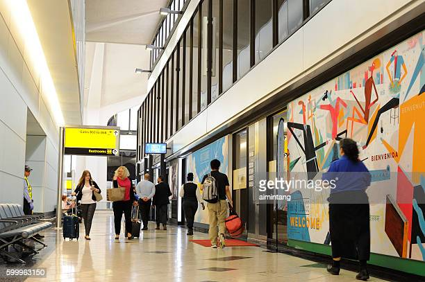 Travelers walking in terminal at Newark Airport