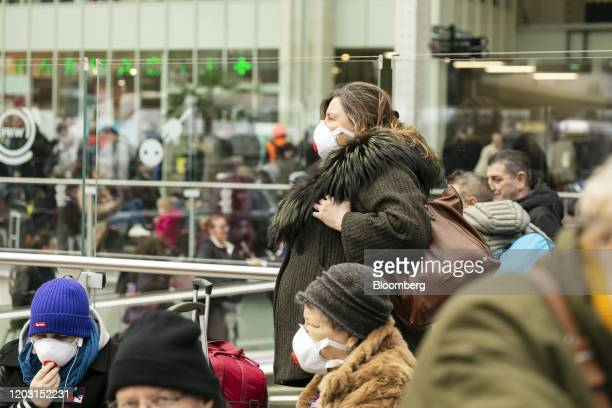 Travelers wear face masks at Paris at Gare de Lyon railway station in Paris France on Tuesday Feb 25 2020 Fashion weeks in New York London Milan and...