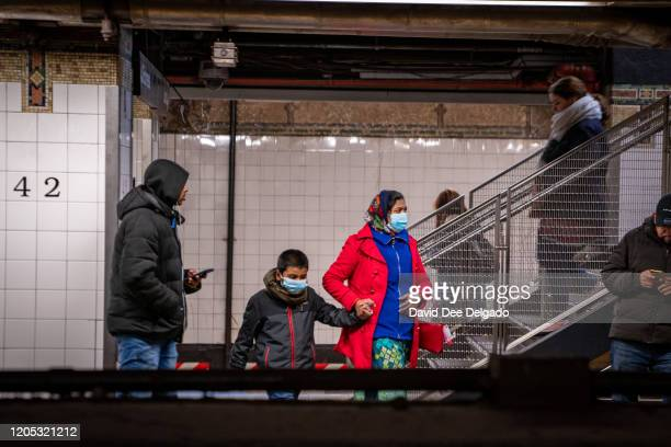 Travelers wear medical masks at Grand Central station on March 5 2020 in New York City Six people have been infected with the COVID19 virus in New...