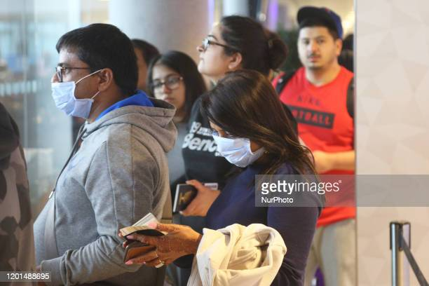 Travelers wearing face masks to protect from them the novel coronavirus while travelling through Abu Dhabi International Airport in Abu Dhabi United...