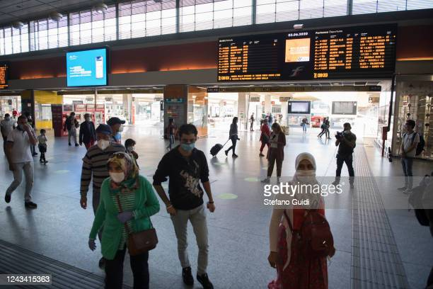 Travelers wearing face masks walk by at the Porta Nuova railway station on June 03 2020 in Turin Italy Today 3 June the Italian government has...
