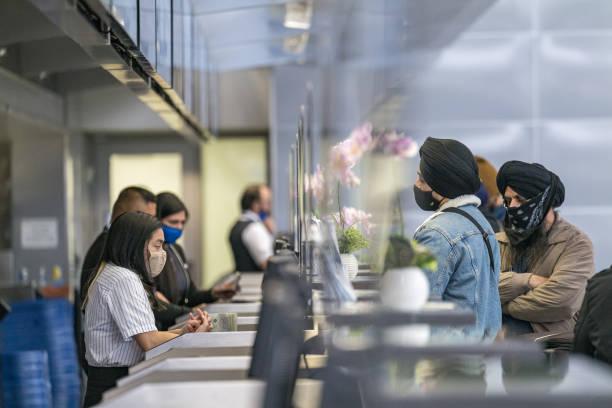 CA: Travelers At SFO Airport As U.S. Holiday Air Travel Surges