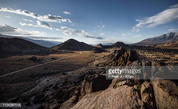 traveling across high desert - alabama hills stock photos and pictures