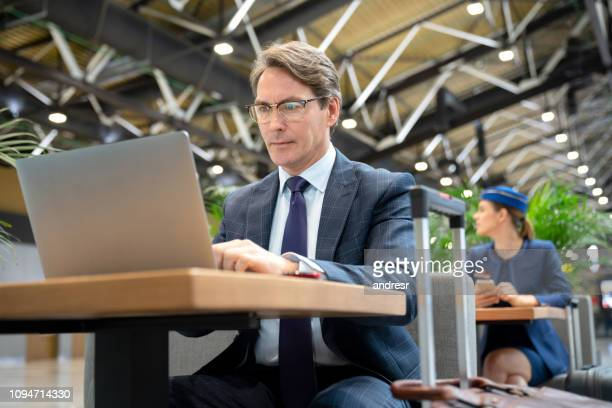 Traveling business man working online at the airport