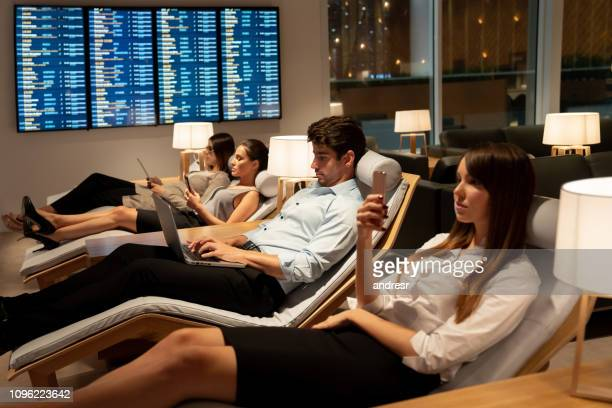 traveling business people relaxing in a vip lounge at the airport - gate stock pictures, royalty-free photos & images