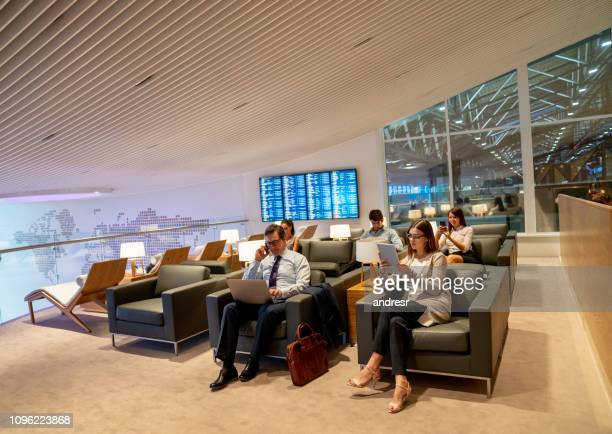 Traveling business people relaxing in a VIP lounge at the airport