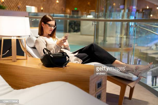traveling business woman relaxing in a vip lounge at the airport - gate stock pictures, royalty-free photos & images