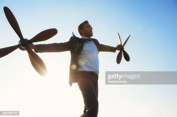 Traveling Businessman Flying with Propellers Against the Sun
