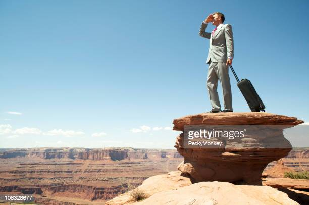 Traveling Businessman Looks Out over Grand Canyon Landscape
