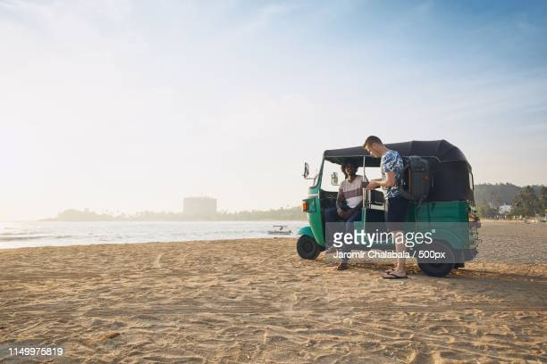 traveling by tuk tuk taxi - auto rickshaw stock pictures, royalty-free photos & images