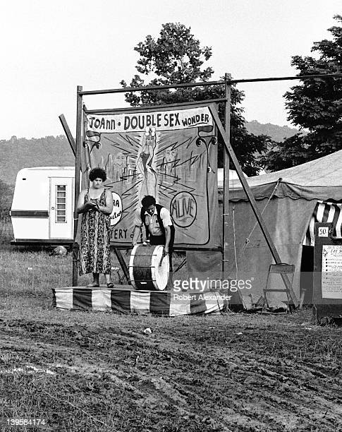 A traveling circus sideshow attracts customers to see JoAnn the Doublesex Wonder during a stop in the small town of Abingdon Virginia JoAnn also...