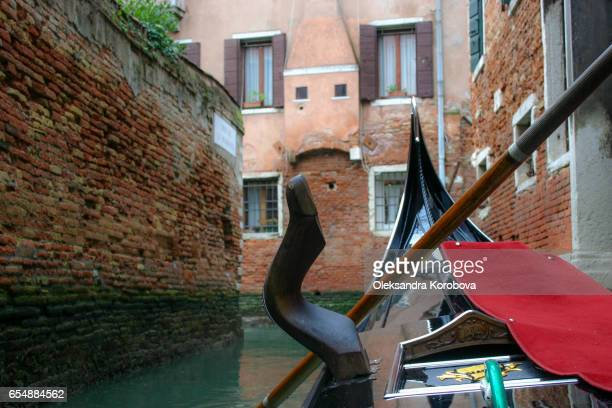 traveling down the canals in venice from the point of view of a person in the gondola - gondola traditional boat stock pictures, royalty-free photos & images