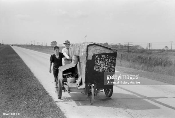 Traveling Evangelists Pushing Cart on Road between Lafayette and Scott, Louisiana, USA, Russell Lee, Farm Security Administration, October 1938.