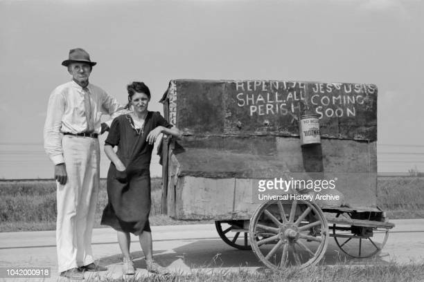 Traveling Evangelists with Cart on Road between Lafayette and Scott, Louisiana, USA, Russell Lee, Farm Security Administration, October 1938.