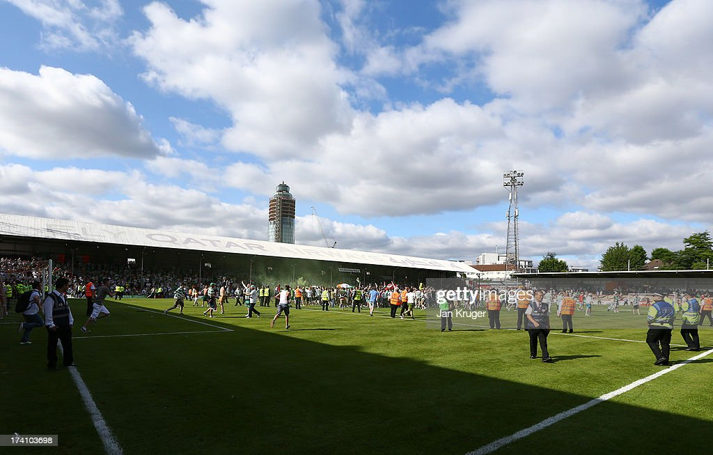 Traveling fans invade the pitch at the final whistle during a pre season friendly match between Brentford and Celtic at Griffin Park on July 20, 2013 in Brentford, England.